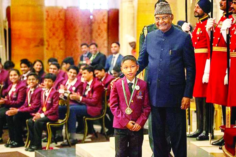 President Ram Nath Kovind presents Pradhan Mantri Rashtriya Bal Puraskar, 2020 (National Bravery Award) to Lalkansung at Rashtrapati Bhawan, in New Delhi on Wednesday.