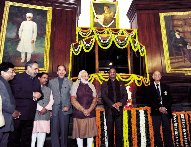 Prime Minister Narendra Modi with other leaders pose for a photograph after paying floral tributes to Netaji Subhas Chandra Bose on the occasion of his birth anniversary in the Central Hall of Parliament House, in New Delhi on Thursday. (UNI)