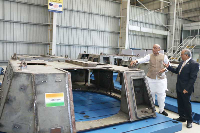 Defence Minister Rajnath Singh touring the L&T Armoured System Complex at Hazira, Gujarat on Thursday. (UNI)