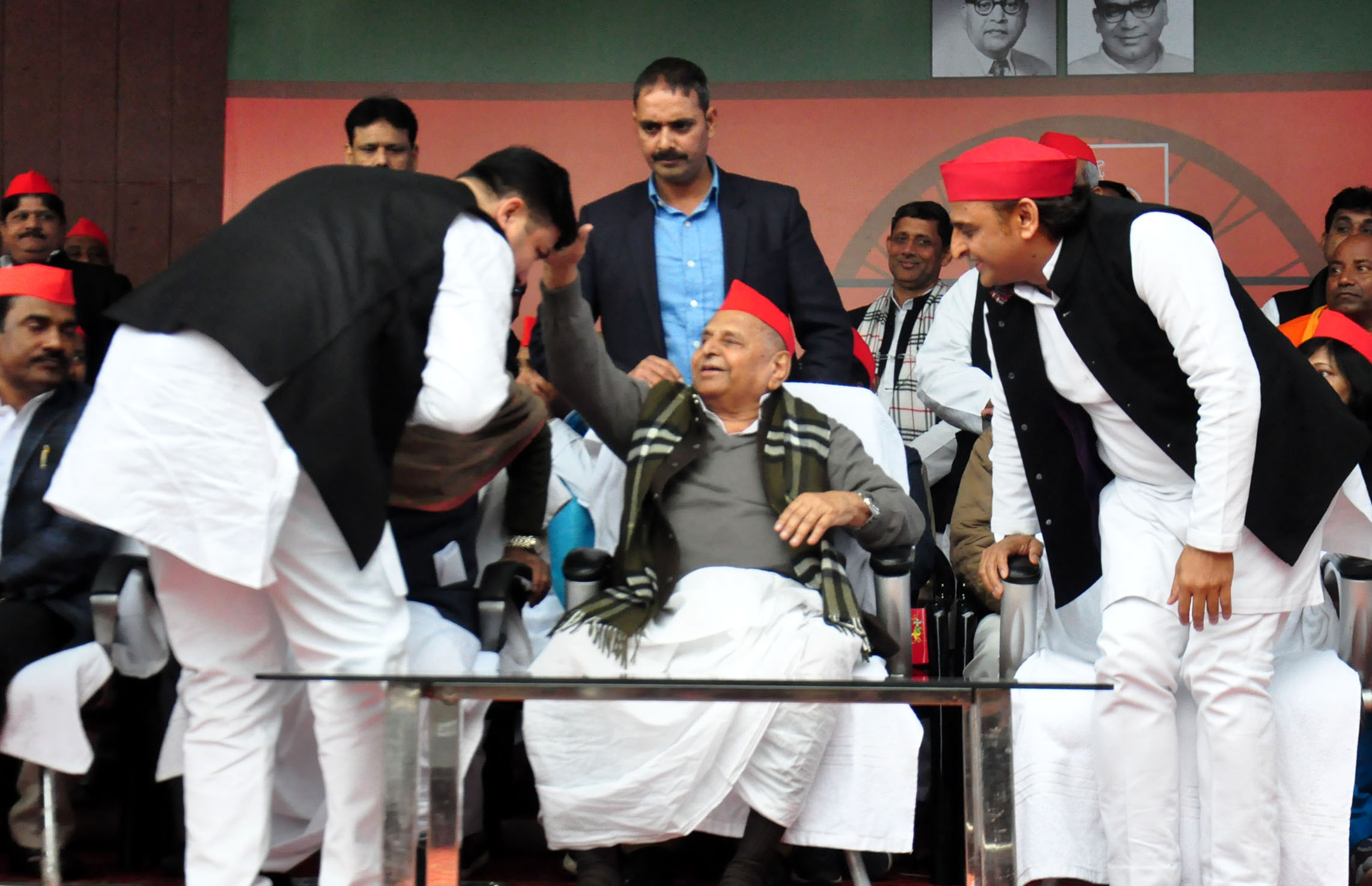 Former Chief of Hindu Yuva Vahini Sunil Singh bleassing from Mulayam Singh Yadav (Samajwadi Party founder) during join-membership programme at party office in Lucknow on Saturday. (UNI)