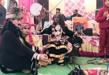 Local artists enacting a religious play at Baba Kaliveer Shrine in Kathua on Sunday.