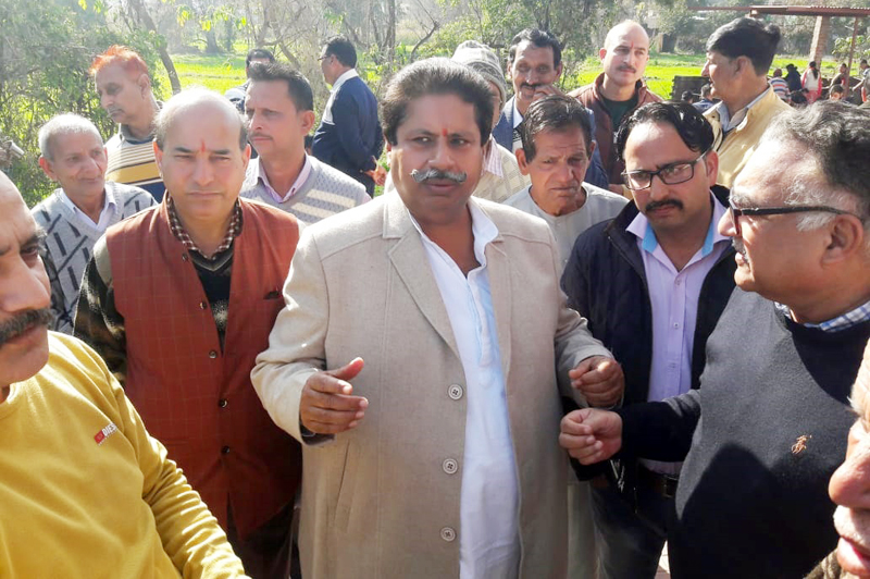 Senior Cong leader Raman Bhalla interacting with people at Bhour camp in jammu on Sunday.