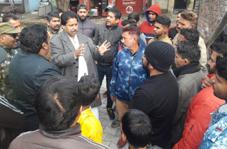 PCC leader, Raman Bhalla interacting with people in Gandhi Nagar on Saturday.