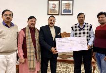 Union Minister Dr Jitendra Singh being handed over a cheque of Rs. 25 lakh for Prime Minister's National Relief Fund (PMNRF), in the presence of BJP National Vice President, Shyam Jaju, at New Delhi on Friday.