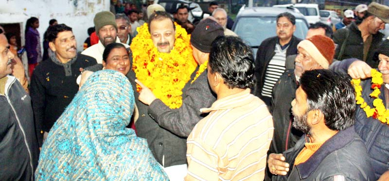 NC Provincial President Devender Singh Rana interacting with people.