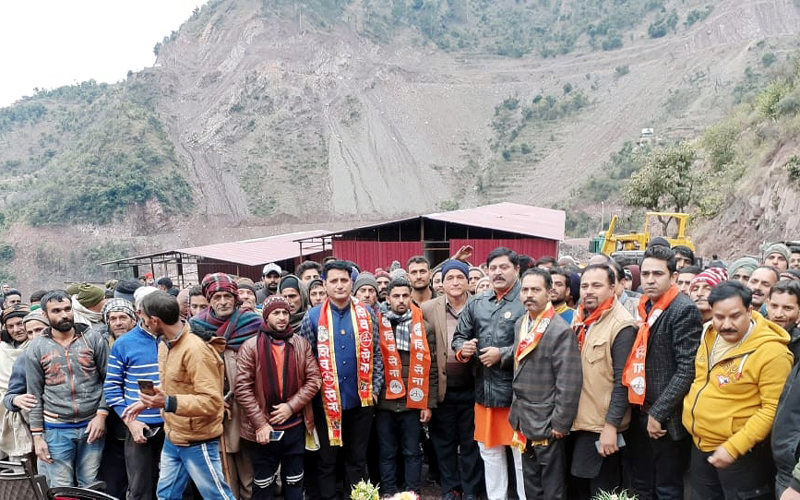 Shiv Sena leaders with Railway project workers at village Khanikot in Reasi district.