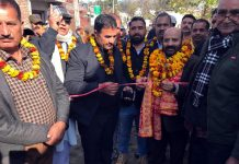 Senior BJP leader Bali Bhagat inaugurating a lane in Panchayat Lower Raipur-A.