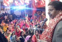 Former Minister, Raman Bhalla addressing gathering during a Bhandara at Preet Nagar Jammu.