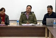Commissioner Secretary Hirdesh Kumar chairing a meeting on Friday.