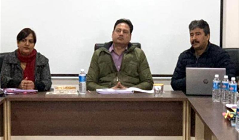 Commissioner Secretary Hirdesh Kumar chairing a meeting on Friday.