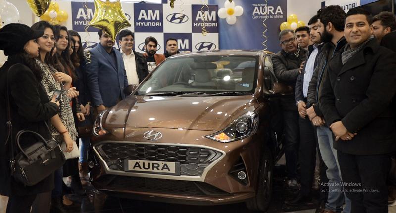 Officials of AM Hyundai Paloura launching All New AURA.