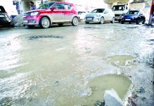A Srinagar road in a worst condition. —Excelsior/Shakeel