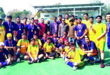 Winners of Intra-Zone (A) Hockey title posing along with dignitaries and officials in Jammu on Tuesday.