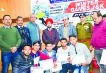 Winners of Winter Games posing along with chief guest and other dignitaries in Kishtwar.