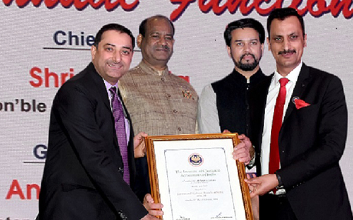 CA Shalay Razdan and CA Vinay Jamwal of J&K ICAI branch receiving award from Speaker Lok Sabha, Om Birla, and MoS Finance, Anurag Thakur, MoS Finance at New Delhi.