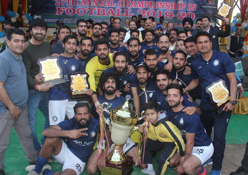 Jubilant players of JK Bank team posing along with dignitaries and officials after receiving winner's trophy at GGM Science College Hostel ground in Jammu. —Excelsior/Rakesh