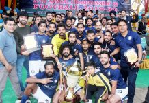 Jubilant players of JK Bank team posing along with dignitaries and officials after receiving winner's trophy at GGM Science College Hostel ground in Jammu.
