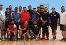 Shuttlers posing along with dignitaries and officials at KC Sports Club in Jammu on Saturday.
