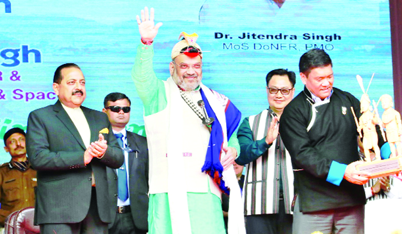 Union Home Minister Amit Shah, dressed in traditional attire,waving to cheering crowds at Itanagar, Arunachal Pradesh on Thursday. Also seen are Minister for Northeast Dr Jitendra Singh, Chief Minister Pema Khandu and MoS Kiren Rijiju.