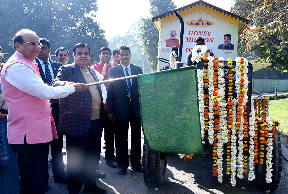 Union Minister for Road Transport and Highways and Micro, Small and Medium Enterprises Nitin Gadkari flagging off Honey Mission: 'Mobile Model Apiary' of Khadi and Village Industries Commission, in New Delhi on Thursday. (UNI)