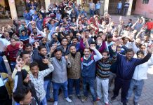 PHE workers staging protest outside Chief Engineer's office at BC Road in Jammu on Sunday. —Excelsior/Rakesh