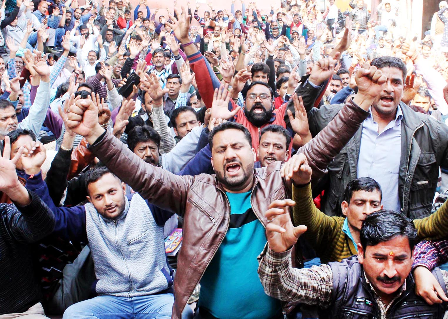 PHE workers staging protest outside Chief Engineer's office at BC Road in Jammu on Monday. -Excelsior/ Rakesh