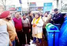 Councillor and officials of JMC during installation of dustbins.