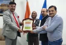 FFMA members presenting a memento to SK Sharma, an eminent litterateur and Additional Commissioner of Income Tax, Jammu.