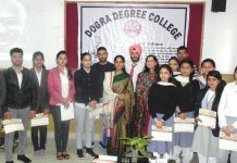 Dr Seema Rohmetra with students who presented their papers on Gandhian Philosophy during seminar at Dogra Degree College.