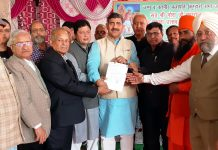 MP Jugal Kishore Sharma presenting a letter regarding sanction of Rs 15 lakh from his MP LAD Fund to President Prajapati Sabha Ayodya Kumar at Jammu.