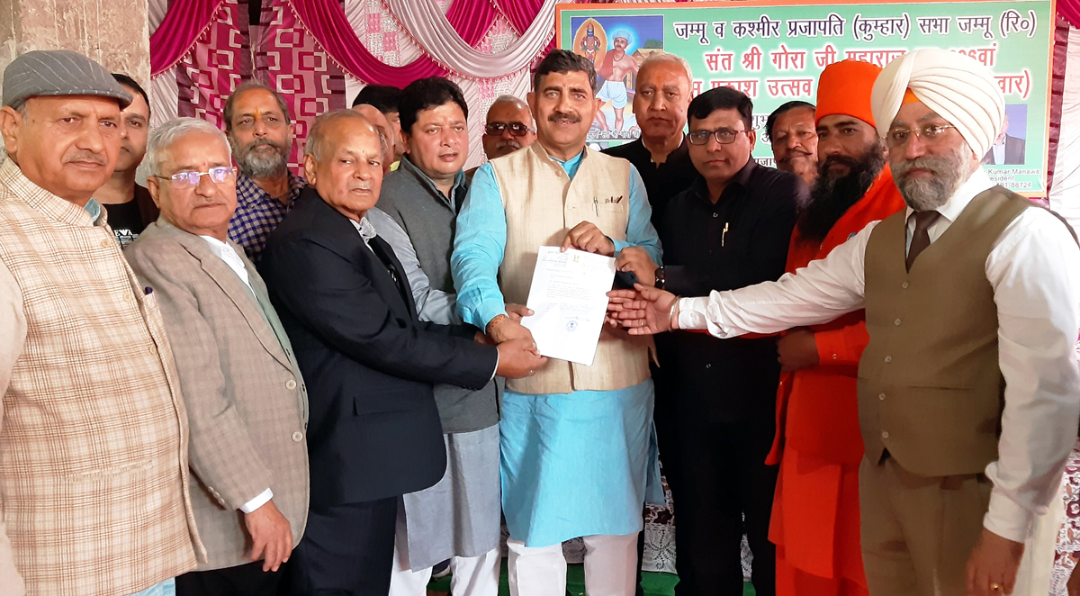 MP Jugal Kishore Sharma presenting a letter regarding sanction of Rs 15 lakh from his MP LAD Fund to President Prajapati Sabha Ayodya Kumar at Jammu.