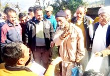 R S Pathania, BJP spokesman interacting with people in Basantgarh area of Ramnagar constituency on Sunday.