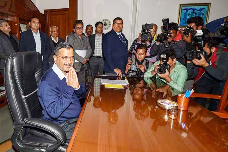 Senior Aam Aadmi Party convenor Arvind Kejriwal takes charge of office as Delhi Chief Minister at Delhi Secretariat, in New Delhi on Monday.
