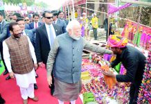 Prime Ministrer Narendra Modi visiting on going Hunar Haat at India Gate Lawns in New Delhi on Wednesday. (UNI)