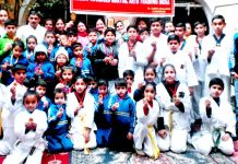 Winners of Martial Art Championship along with dignitaries posing for a group photograph in Jammu.