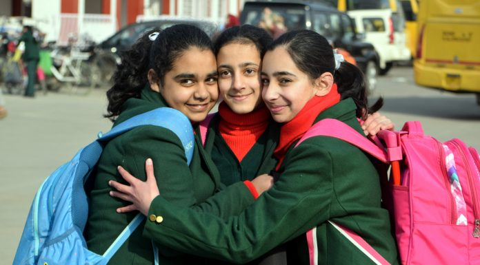 After nearly seven months, students back to schools in Srinagar on Monday. —Excelsior/Shakeel