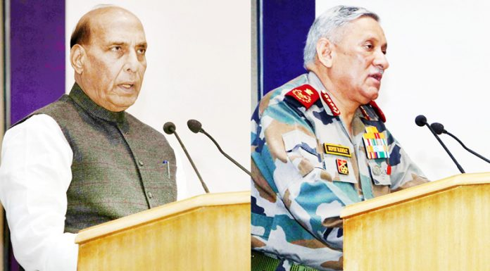 Defence Minister Rajnath Singh and CDS Gen Bipin Rawat addressing a seminar in New Delhi on Friday.