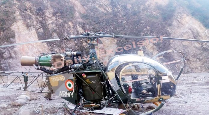 Army helicopter after crash landing in Reasi district on Monday.—Excelsior/Karandeep