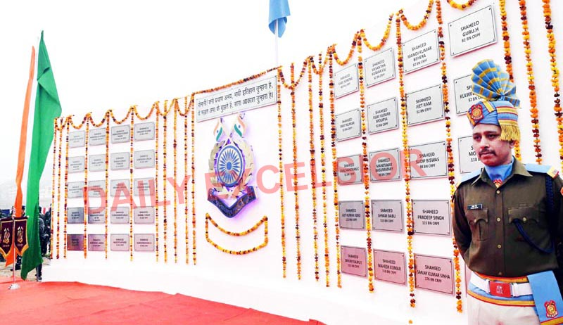 A memorable wall constructed in the CRPF camp at Lethpora, Pulwama on which the names of martyred jawans have been inscribed. -Excelsior/Younis Khaliq