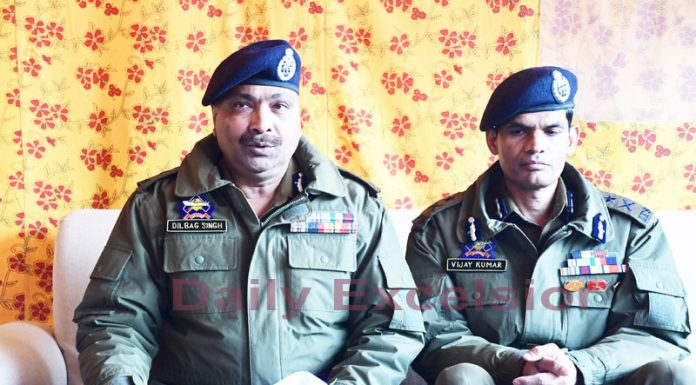 DGP Dilbag Singh addressing a press conference in Srinagar. IGP Kashmir Vijay Kumar was also present. -Excelsior/ Shakeel