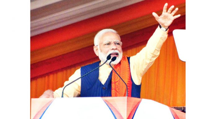 Prime Minister Narendra Modi addressing a public rally in Kokrajhar on Friday.(UNI)