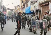 Security forces flag march in violence hit North East Delhi on Thursday.