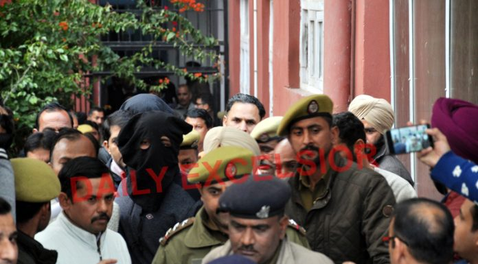 DySP Devinder Singh being producted in the court in Jammu on Thursday. —Excelsior/Rakesh