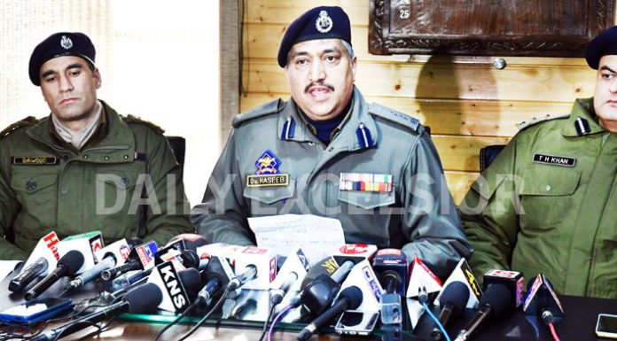 SSP Srinagar Dr Haseeb Mughal addressing a press conference in Srinagar on Friday. -Excelsior/Shakeel