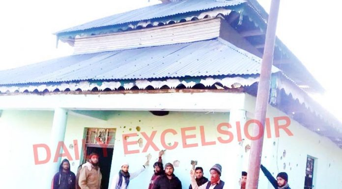 People show bullet marks at the Mosque in Shahpur, Poonch on Friday. -Excelsior/ Gurjeetbhajan