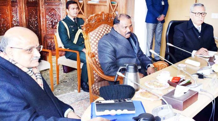 Lieutenant Governor Girish Chandra Murmu chairing a meeting of DMs in Srinagar on Friday.