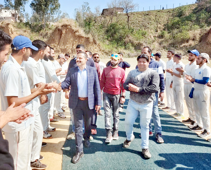 Former MLA Balwant Singh Mankotia interacting with players during a match of Cricket Tournament under Khelo India in Udhampur.