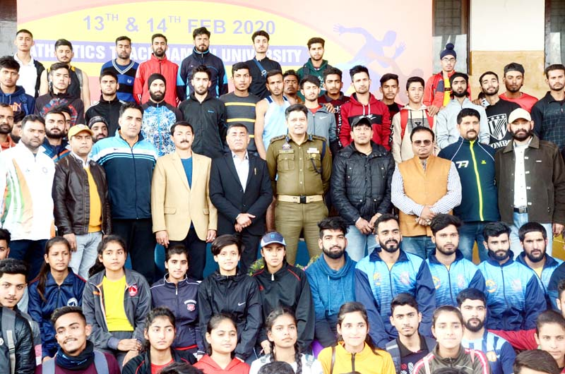 Participants of the J&K Athletics Championship posing along with chief guest at JU grounds in Jammu on Thursday.