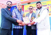 Memento presentation during Annual Day celebration at Nehru Public School Mawa Karoda in Jammu.