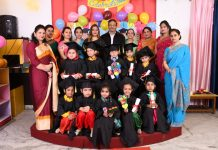 Children in colourful attires posing along with dignitaries and school management during Annual Convocation at Mothers Pride in Jammu.